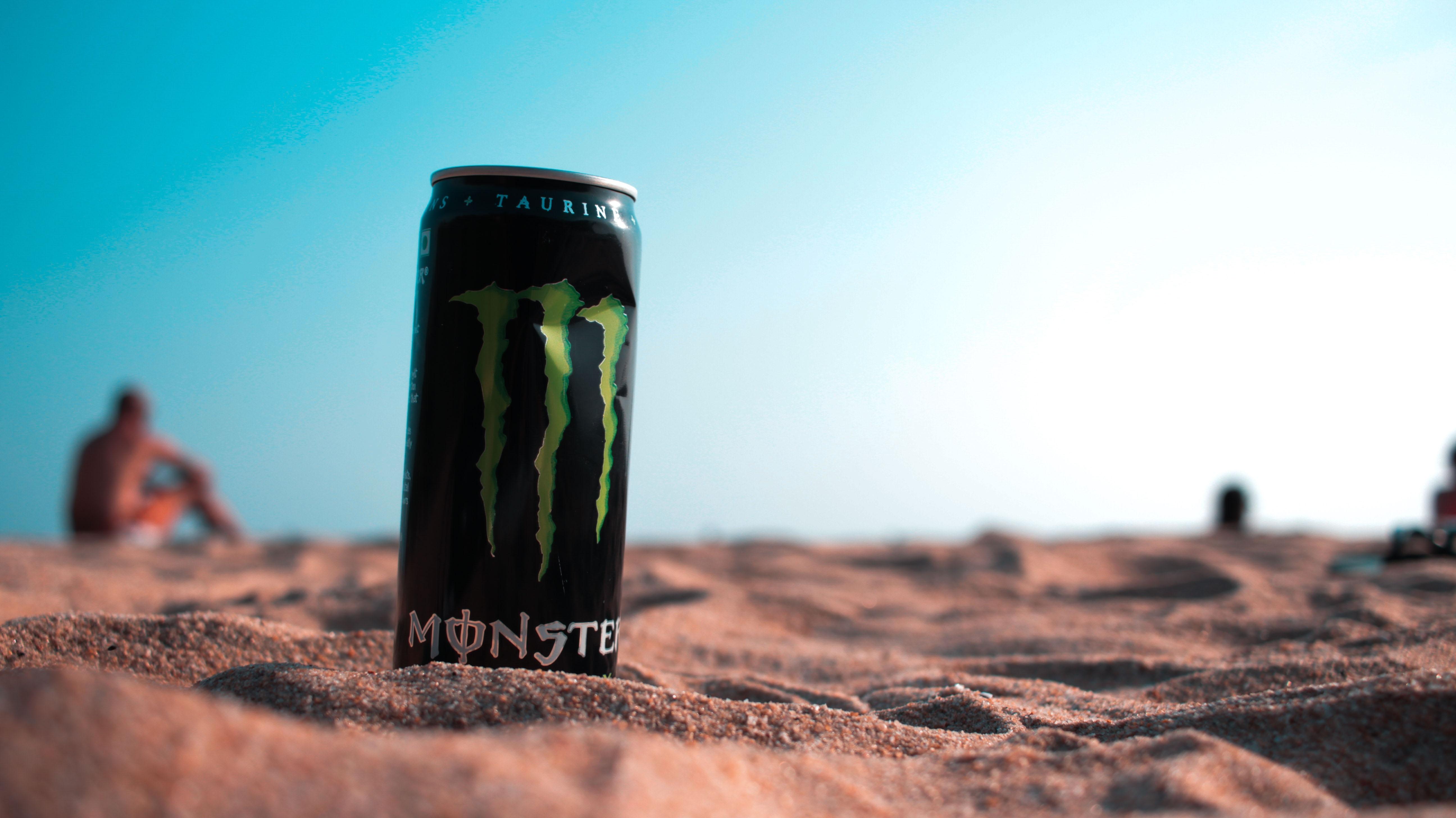 Monster energy drink on sand