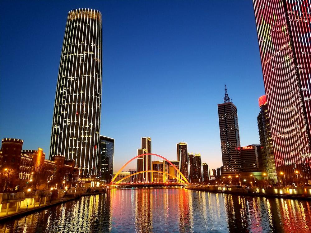 lighted city skyline at dusk