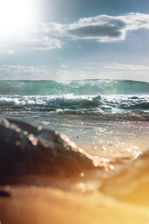 waves breaking in beach at dusk