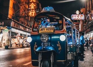 blue auto rickshaw on road
