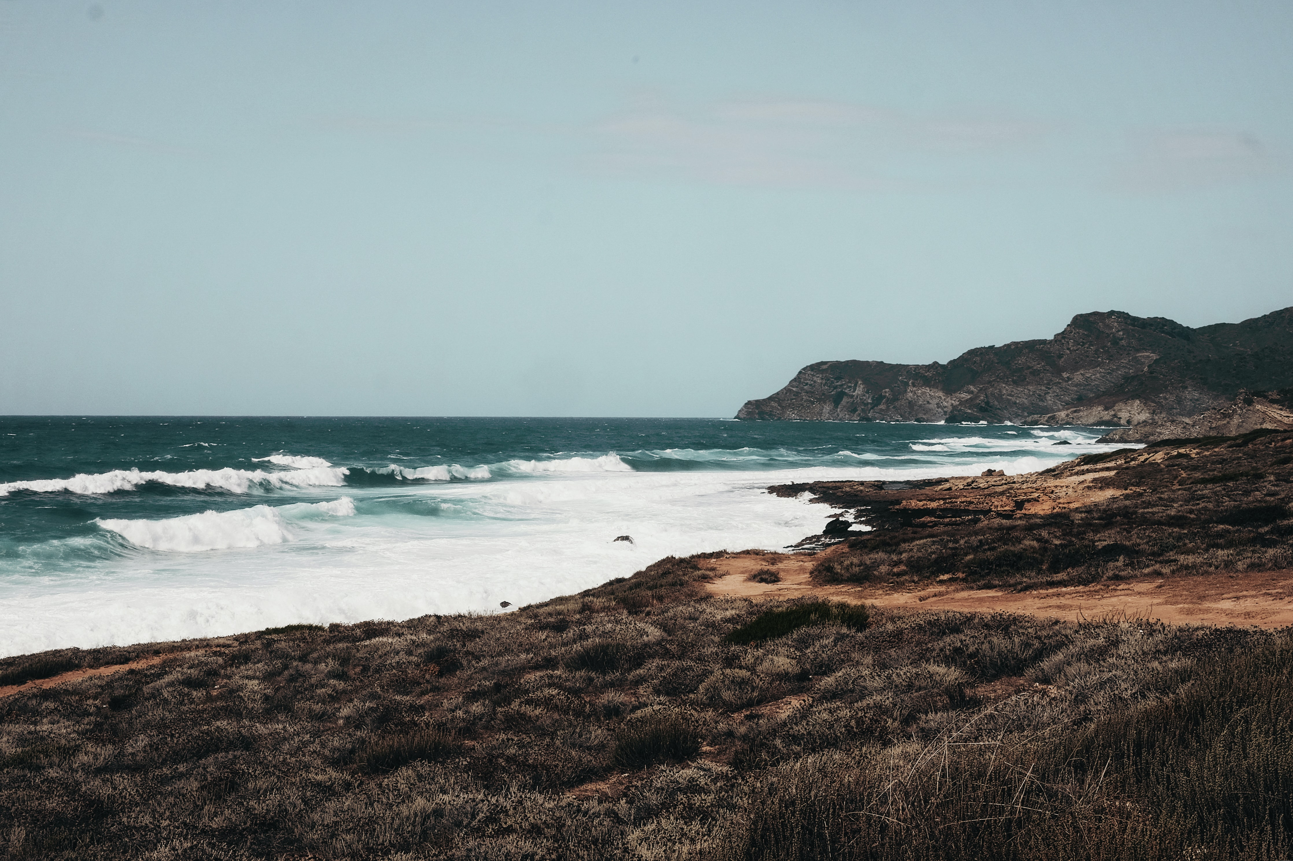 sea waves and rocky hills