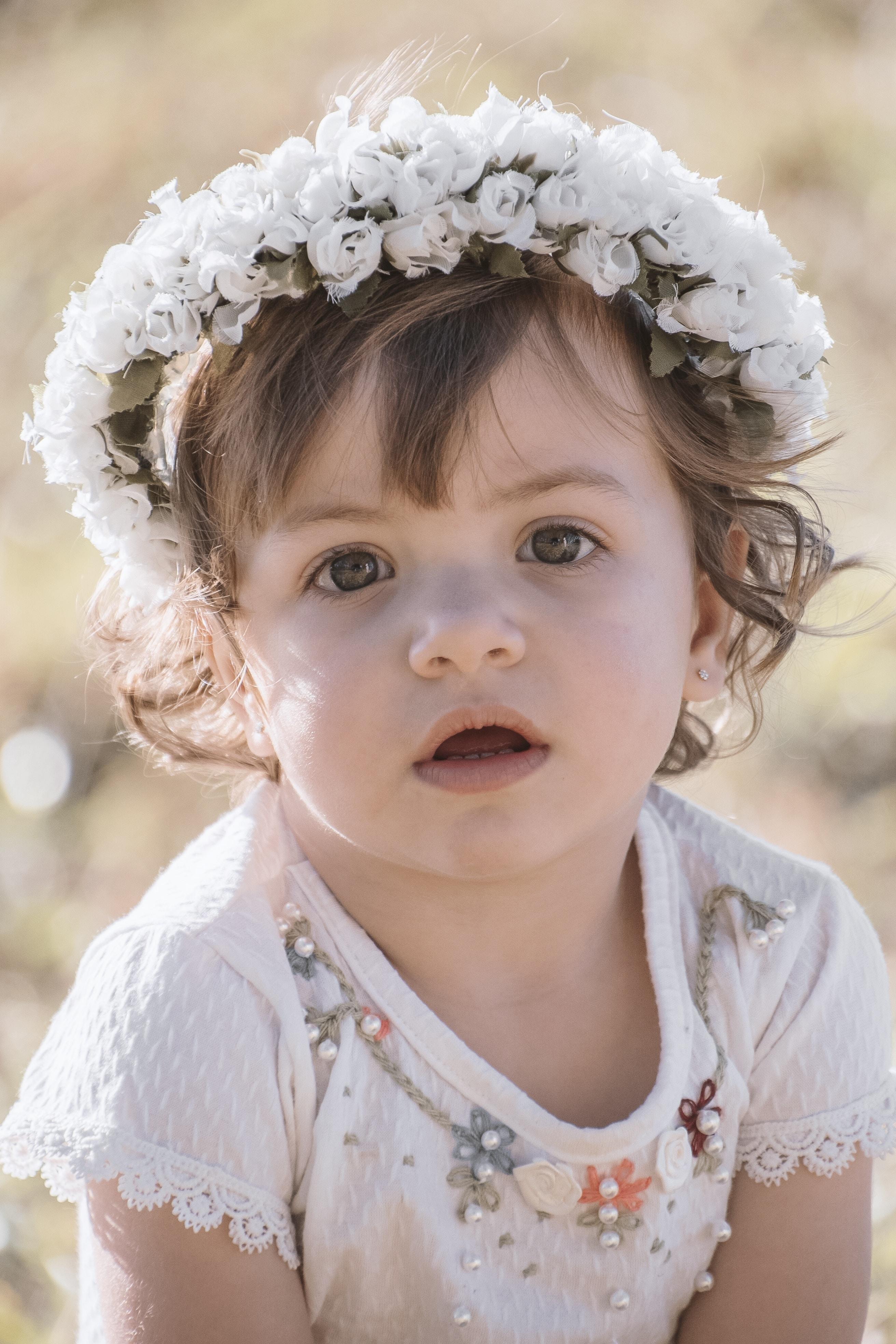 girl in white flower headdress