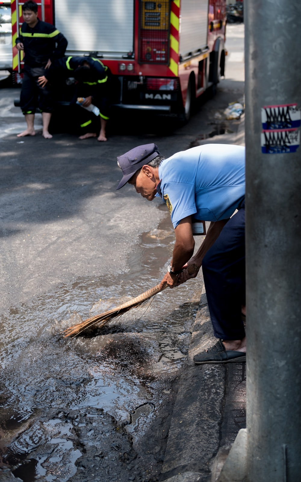 man cleaning at the road