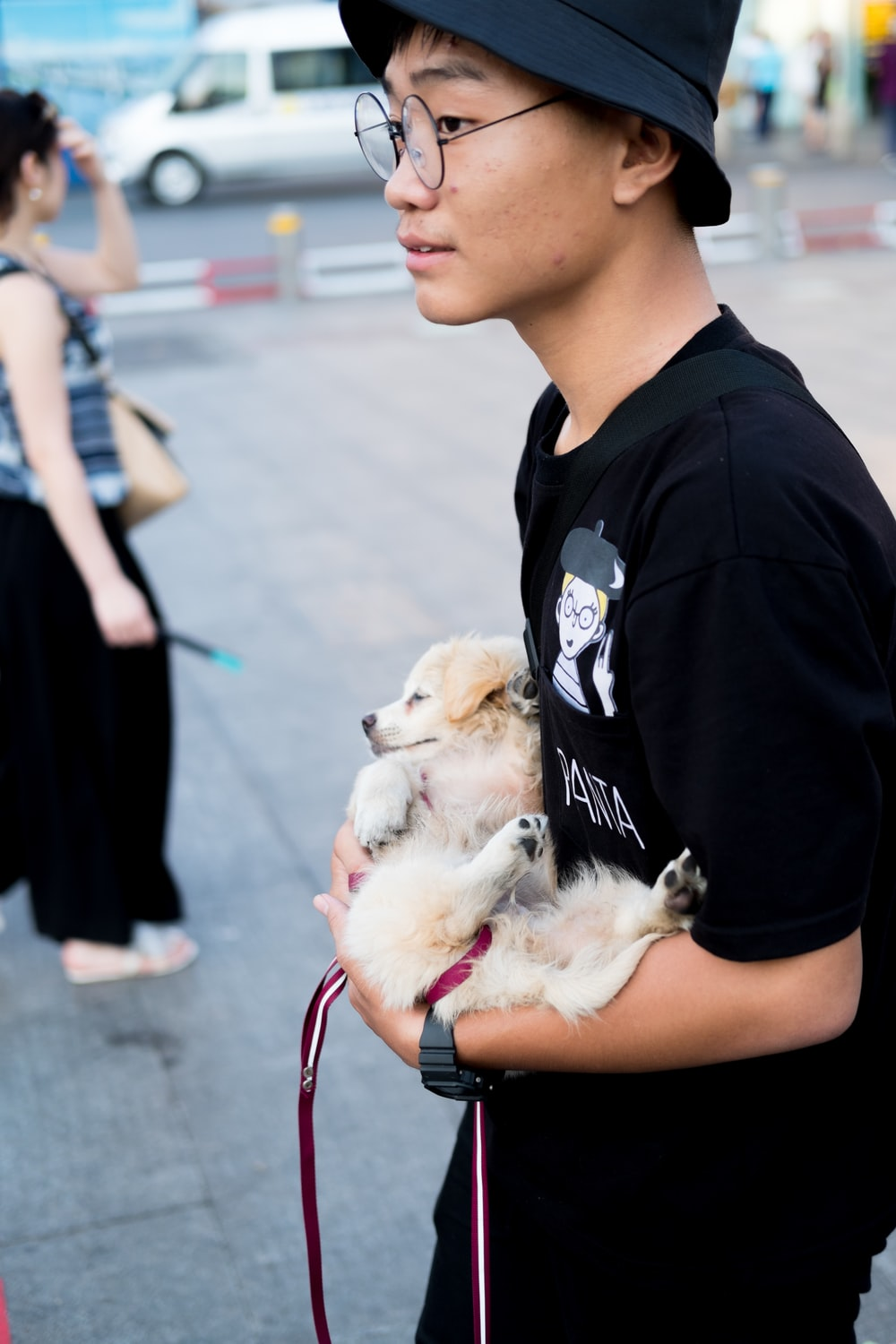 man carrying puppy