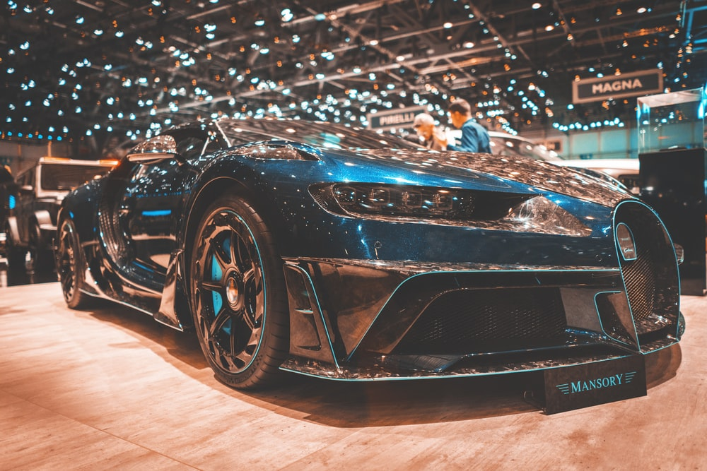 blue Bugatti Veyron parked in well-lit building