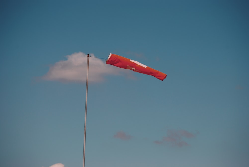 red flag on pole during daytime