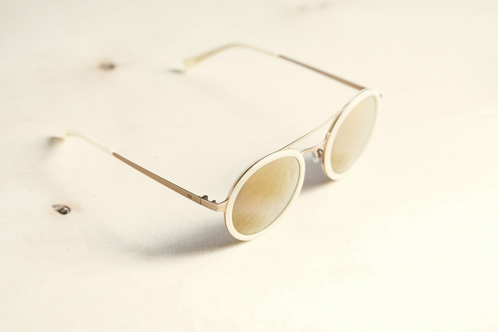 brown lens sunglasses on white surface