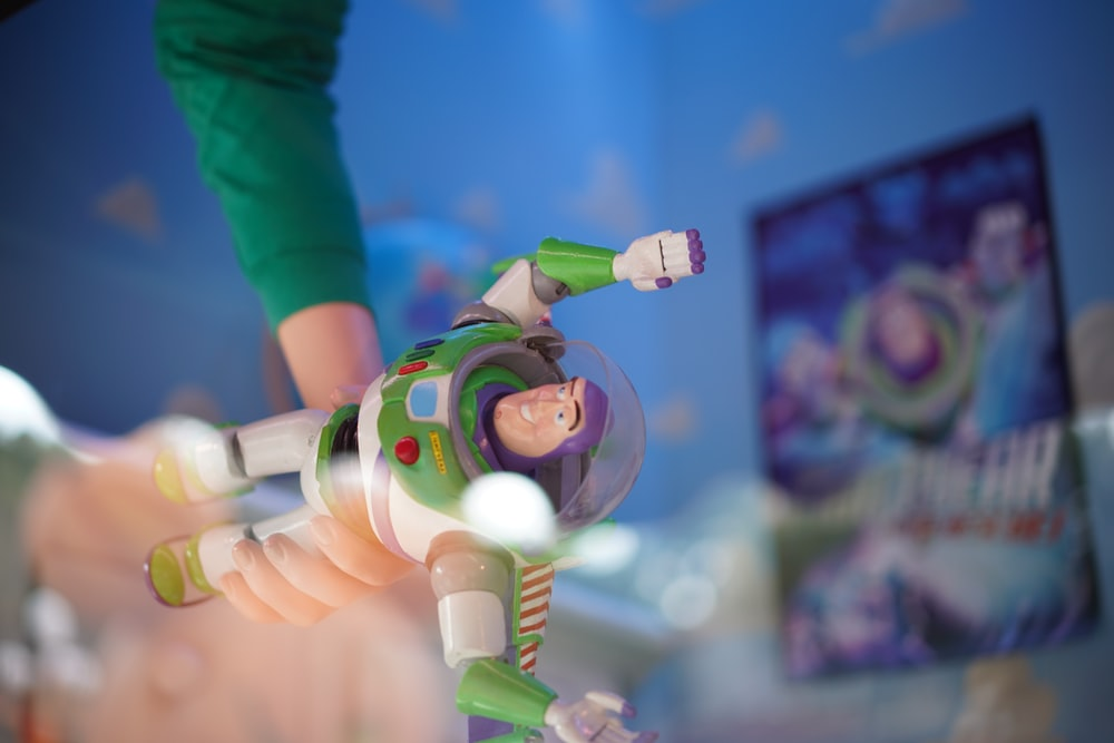 person holding Buzz Lightyear toy