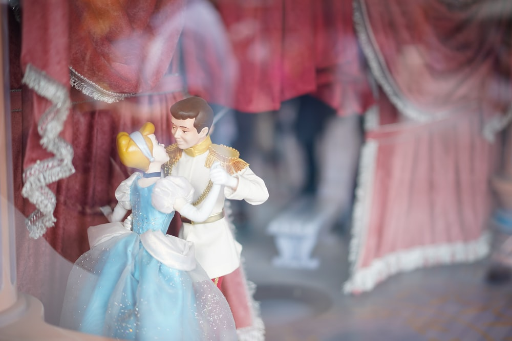 dancing Cinderella and Prince Charming figurine in selective focus photography