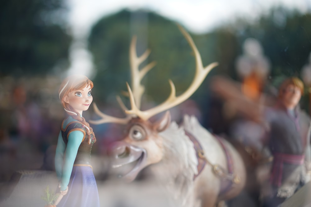 Disney Frozen characters behind glass panel
