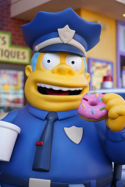police man eating doughnut