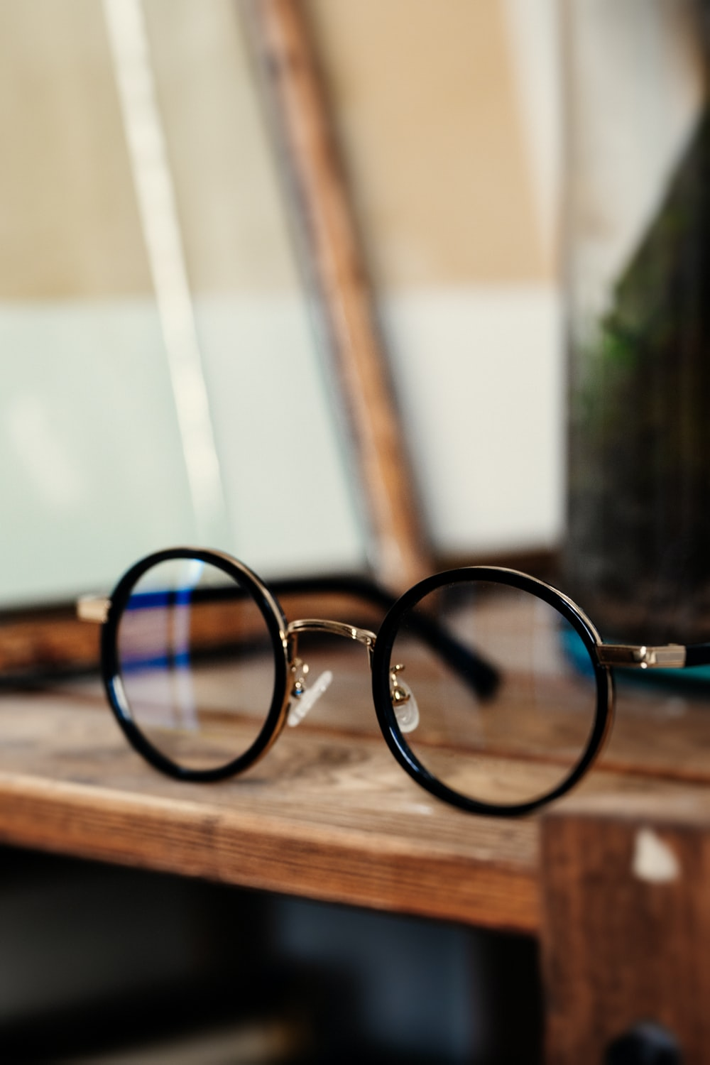 round black framed eyeglasses on table