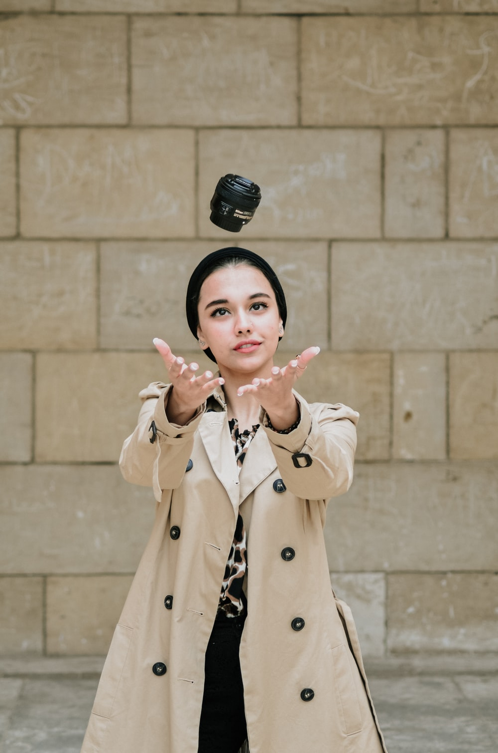 woman holding camera lens