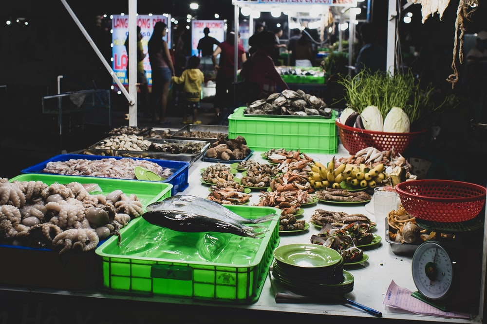 different fish, fruits, and vegetable on display in the market