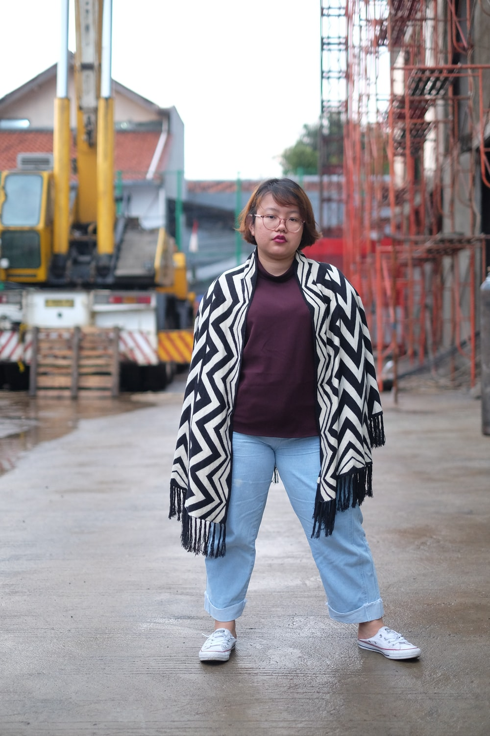 woman standing near construction building