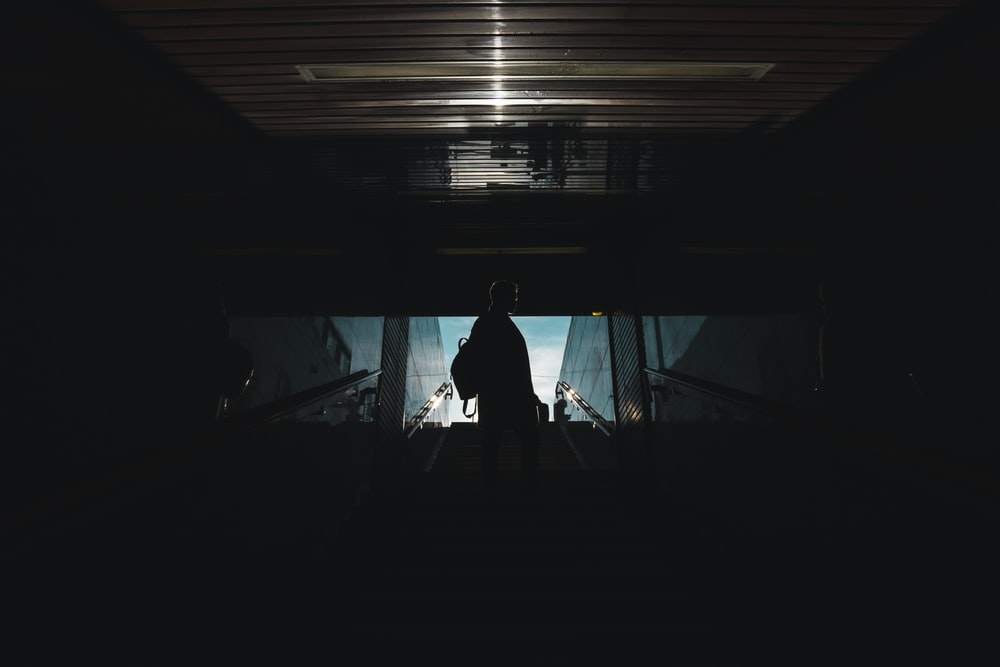 silhouette of person standing inside building