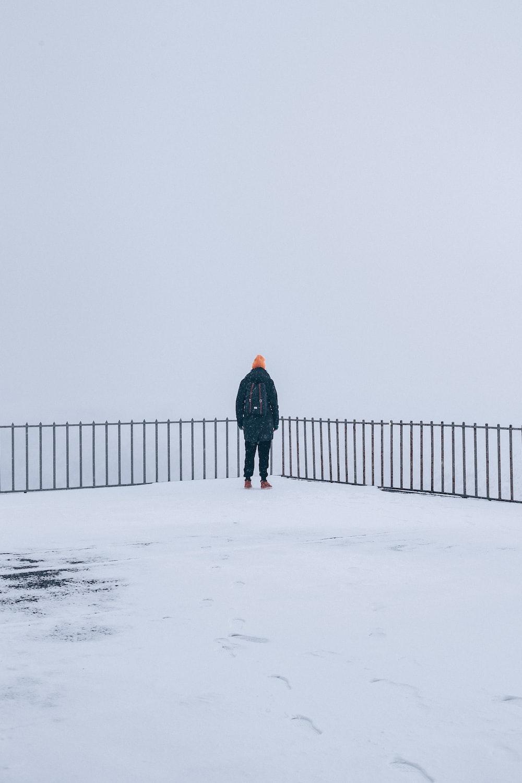 man standing on snow