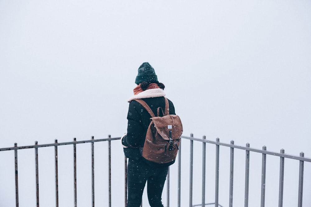 woman standing beside railling