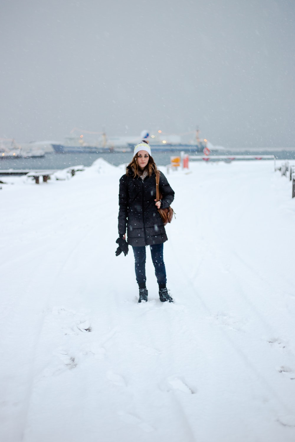 woman standing on snowfield during daytime