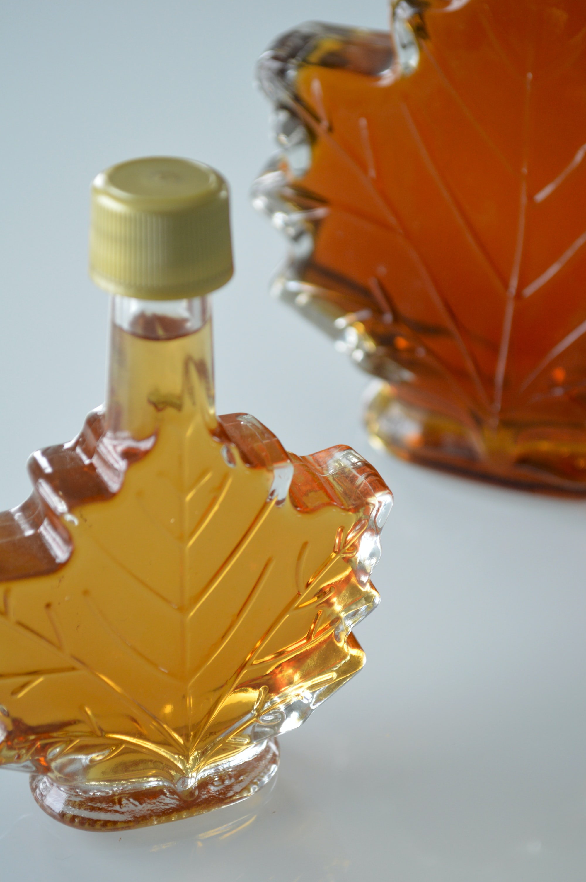 Maple syrup in a bottle on a table