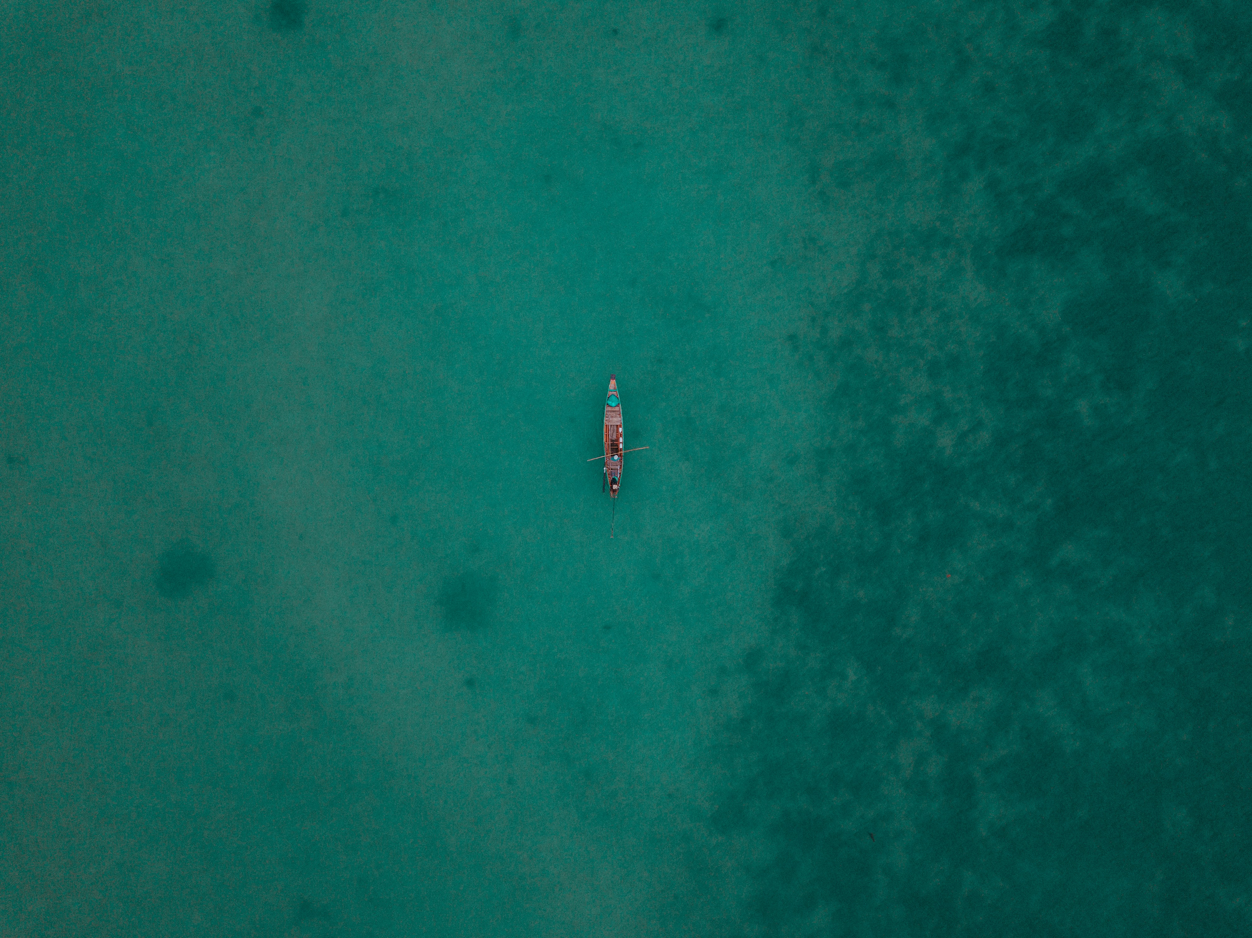 aerial photography of boat at sea