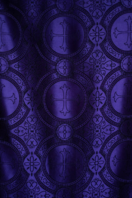 purple and white cross-print textile