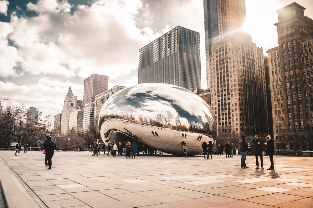 people walking near Cloud Gate in Chicago during daytime