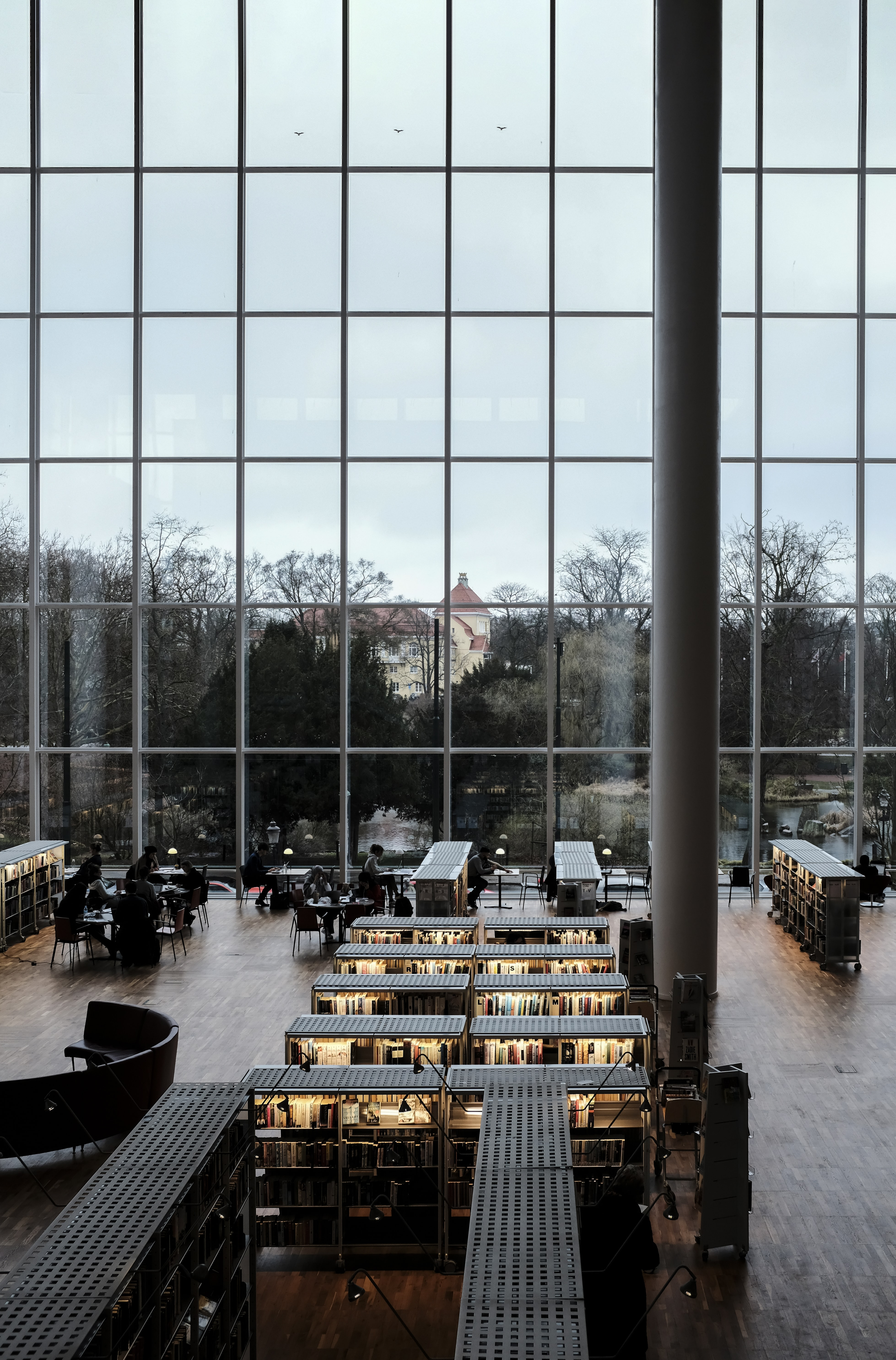 people inside glass building