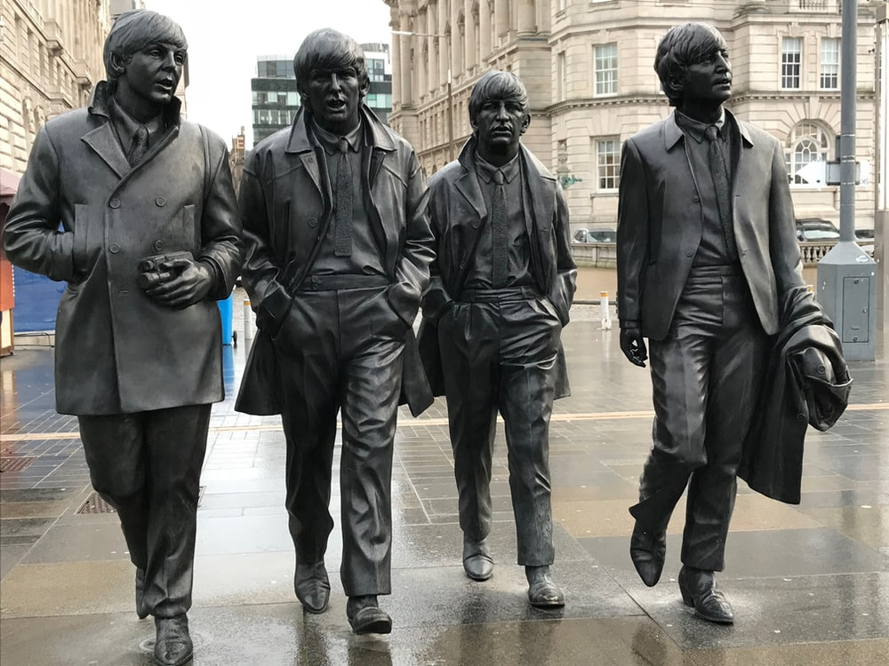4-men group band statues