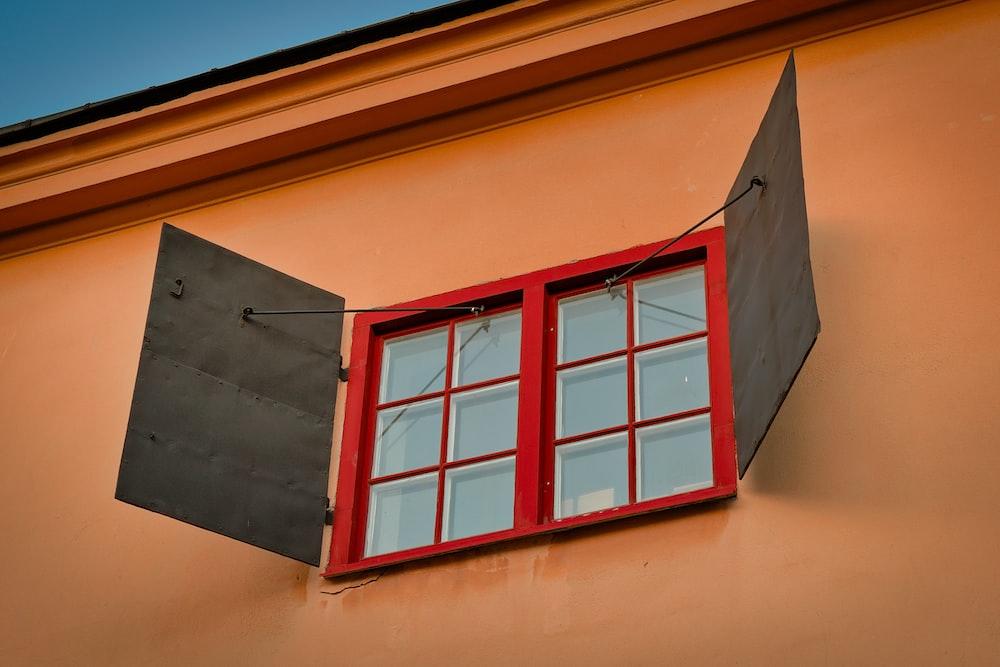 white wooden framed glass window opened