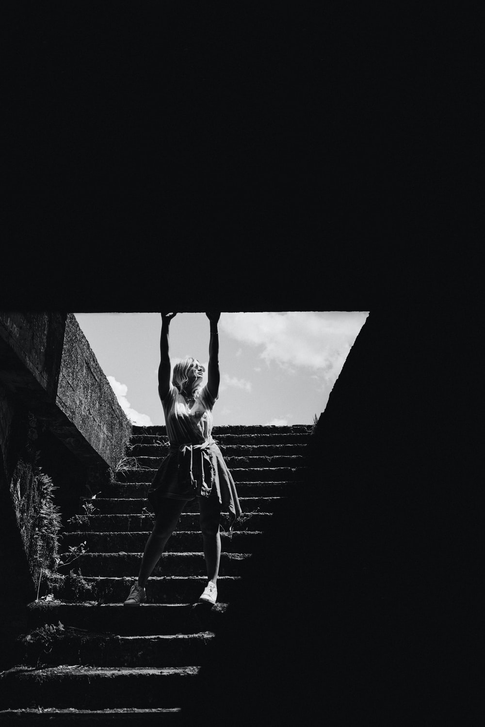 woman standing on staircase