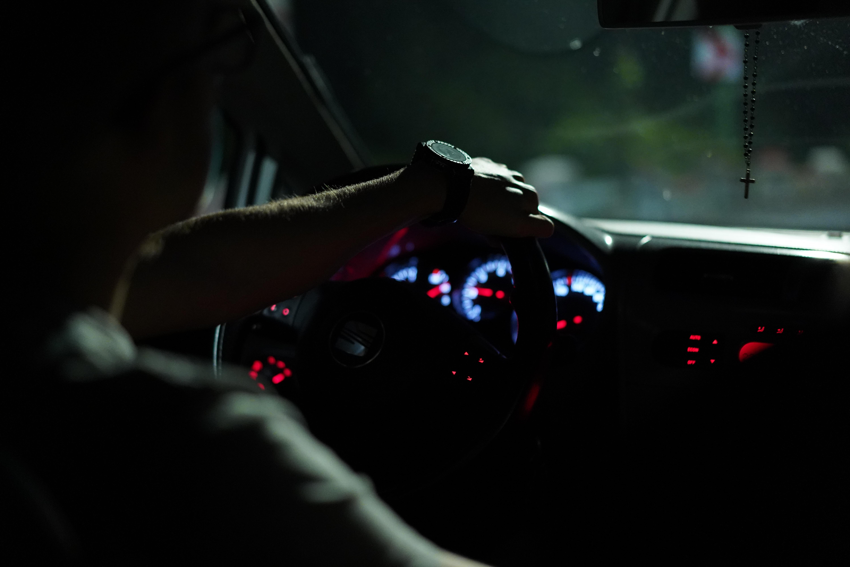 man driving vehicle at nighttime