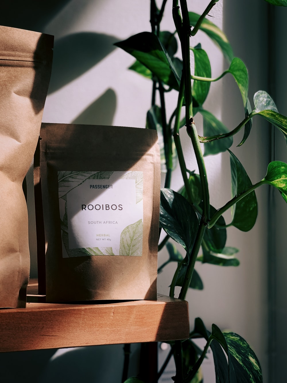 Rooibos pack beside green leafed plant