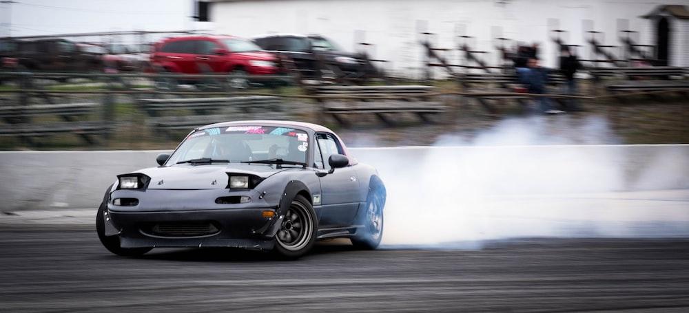 blue drifting car