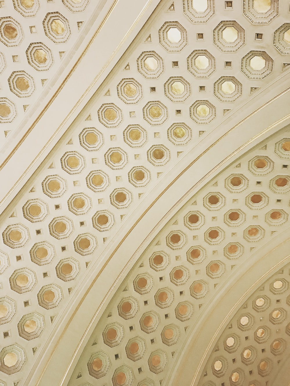 white and gold-colored ceiling