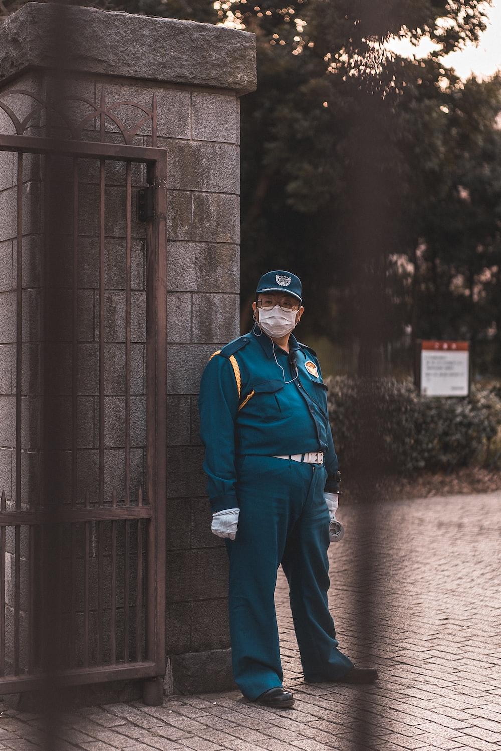 man standing concrete gate