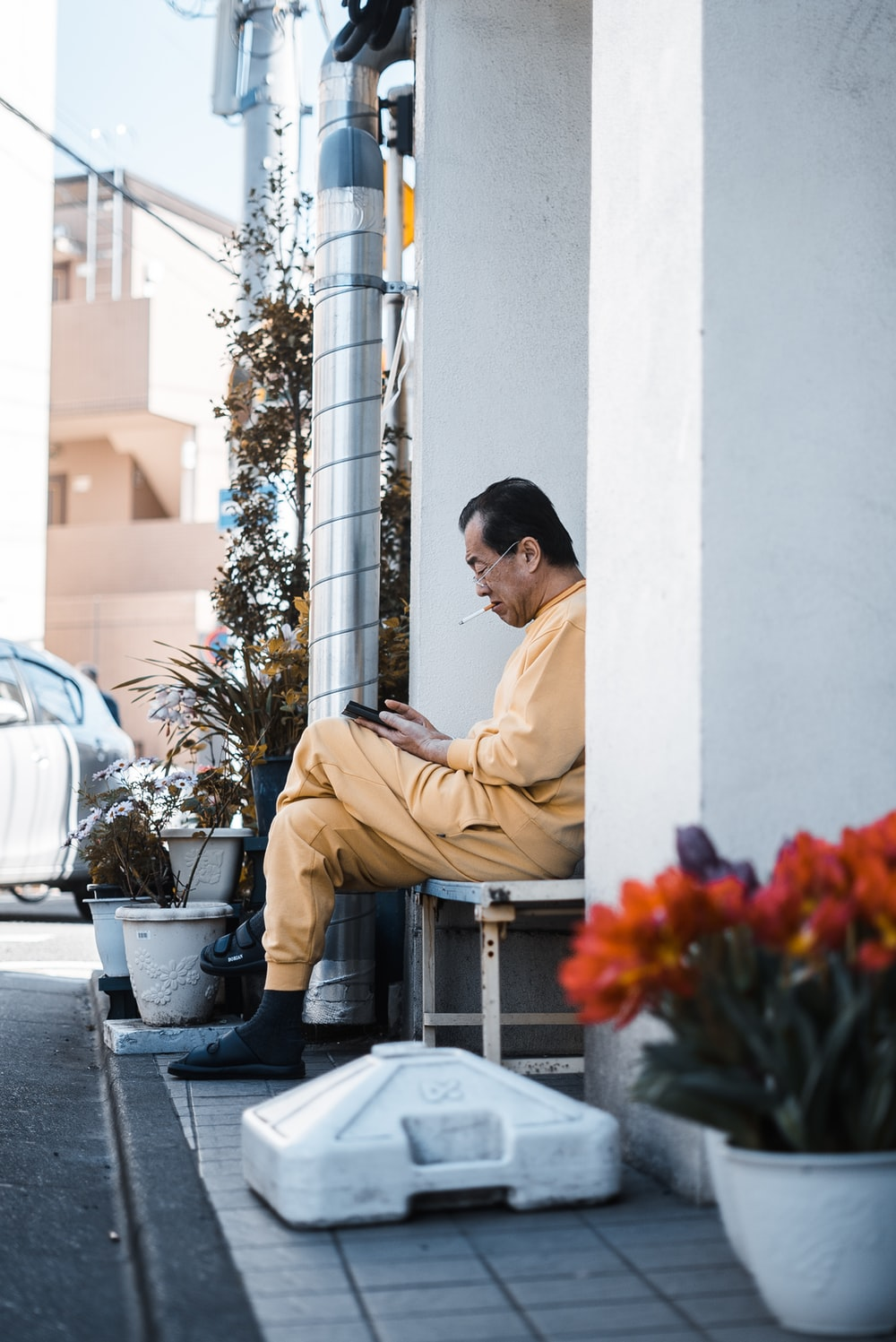 seated man in a yellow jumpsuit