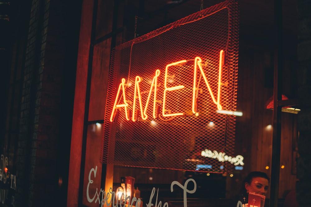 yellow AMEN neon sign