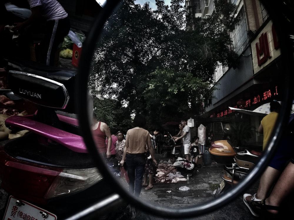 taking photo using motorcycle side mirror