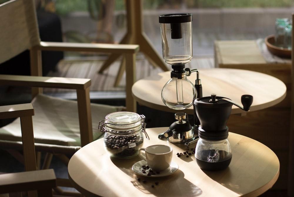 jar of coffee, mug, coffeemaker, and glass bong