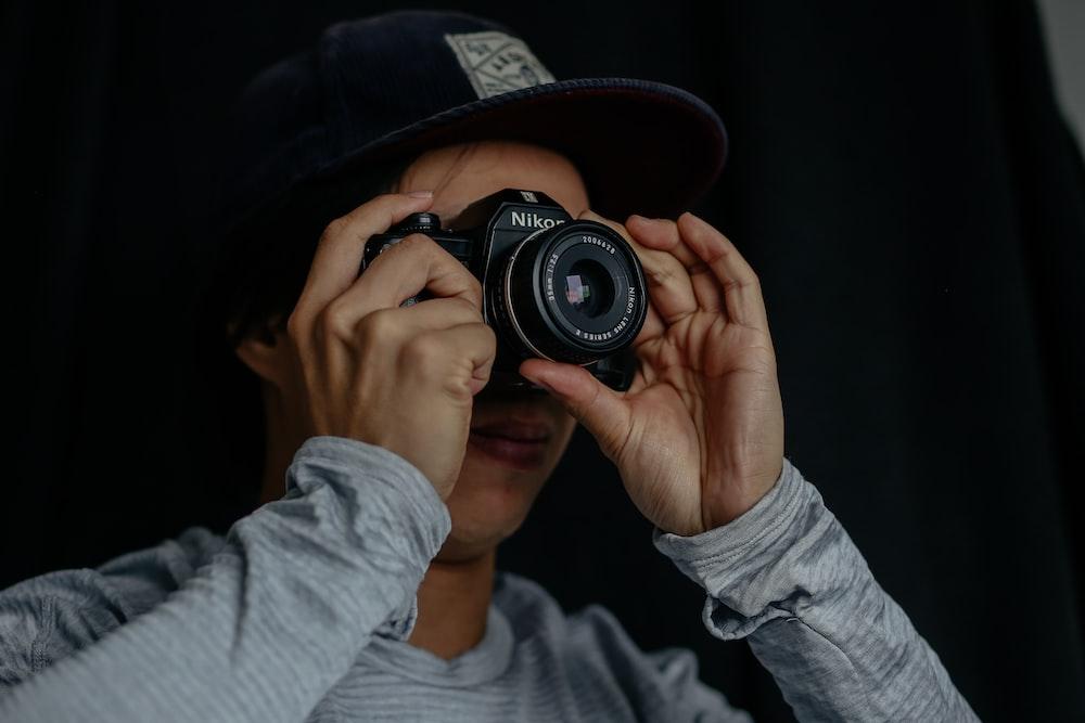 man taking photo using camera