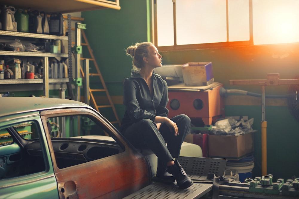 woman sitting on orange vehicle
