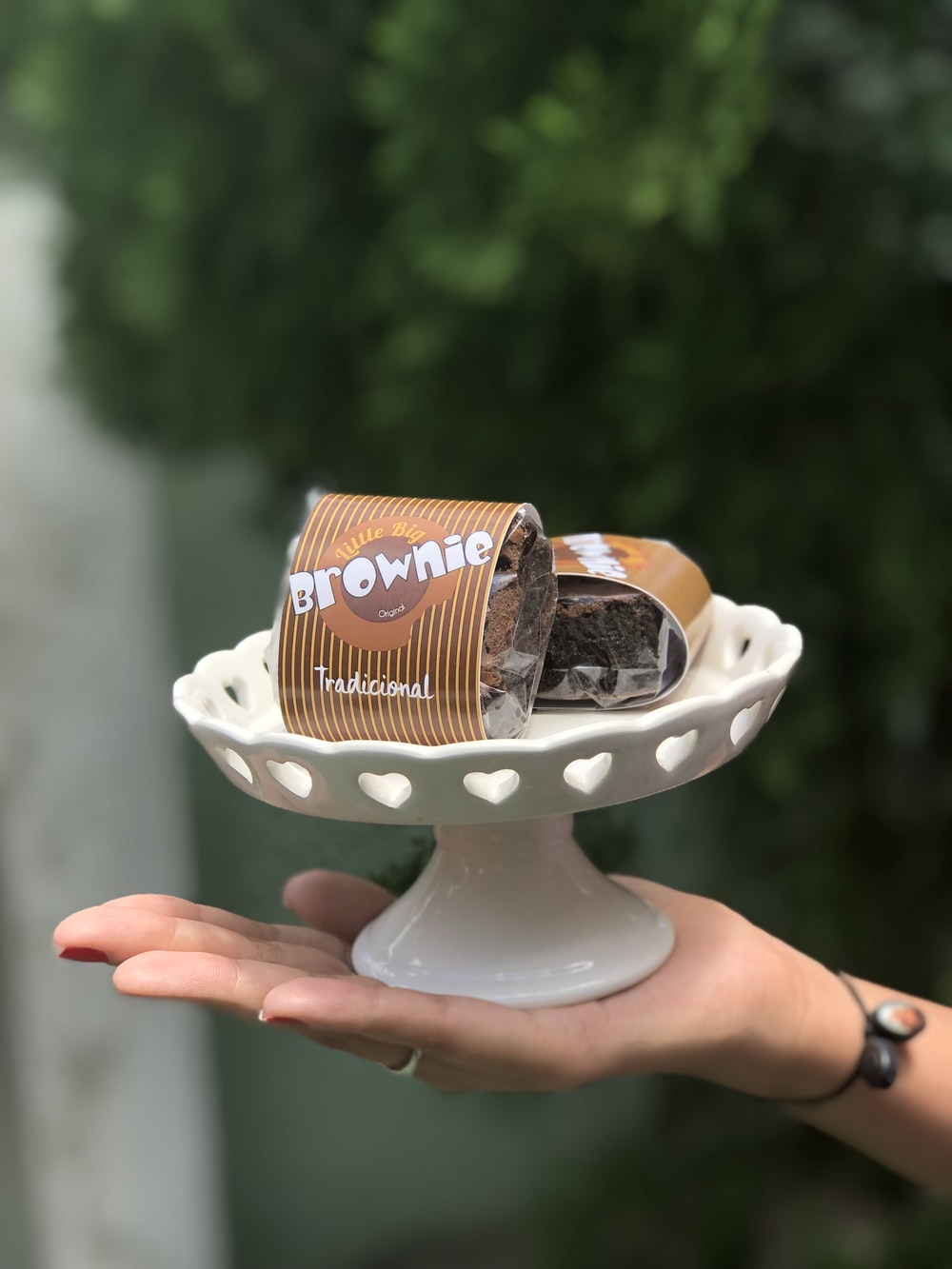 two brown cans and white cake stand