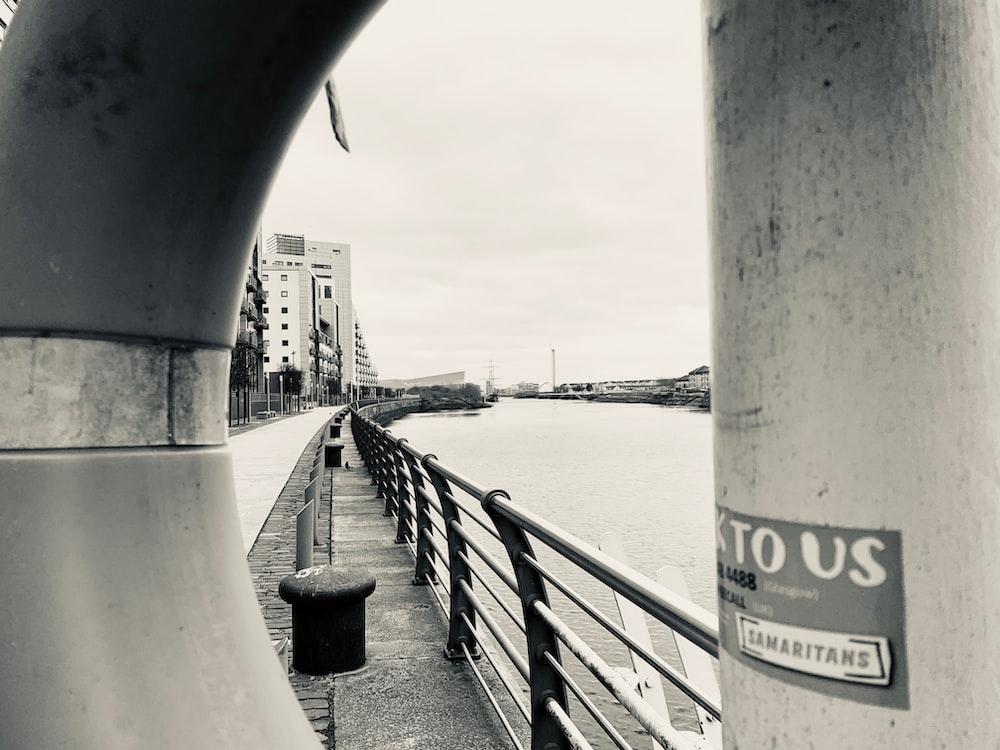 grayscale photo of gray bridge