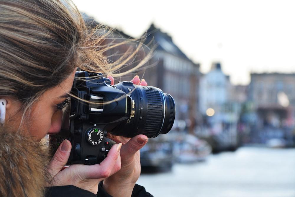 woman using DSLR camera