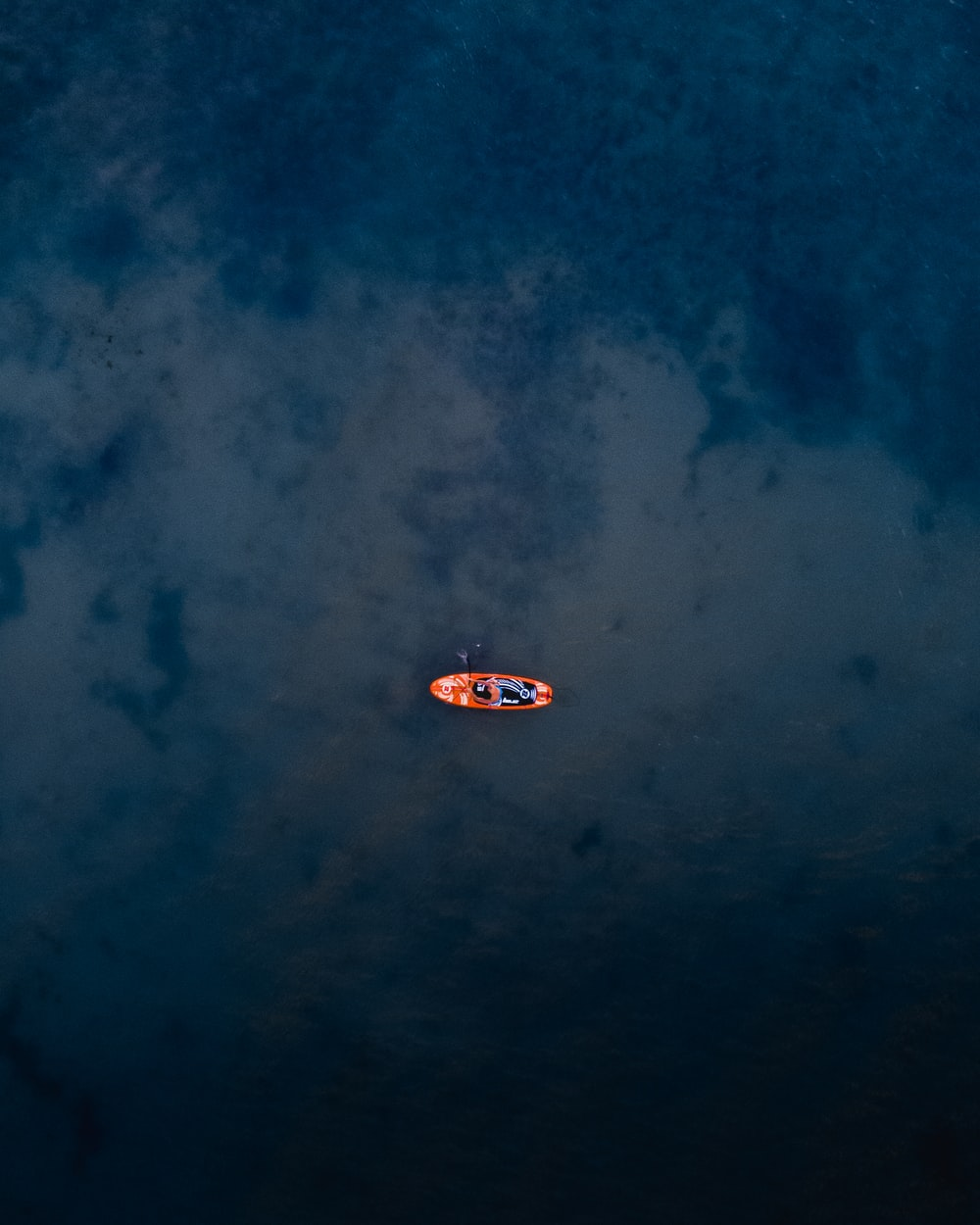 person riding orange canoeboat