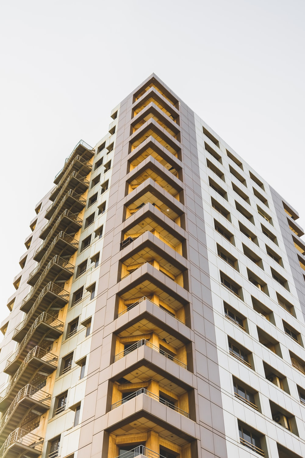 low-angle photography of high-rise building at daytime