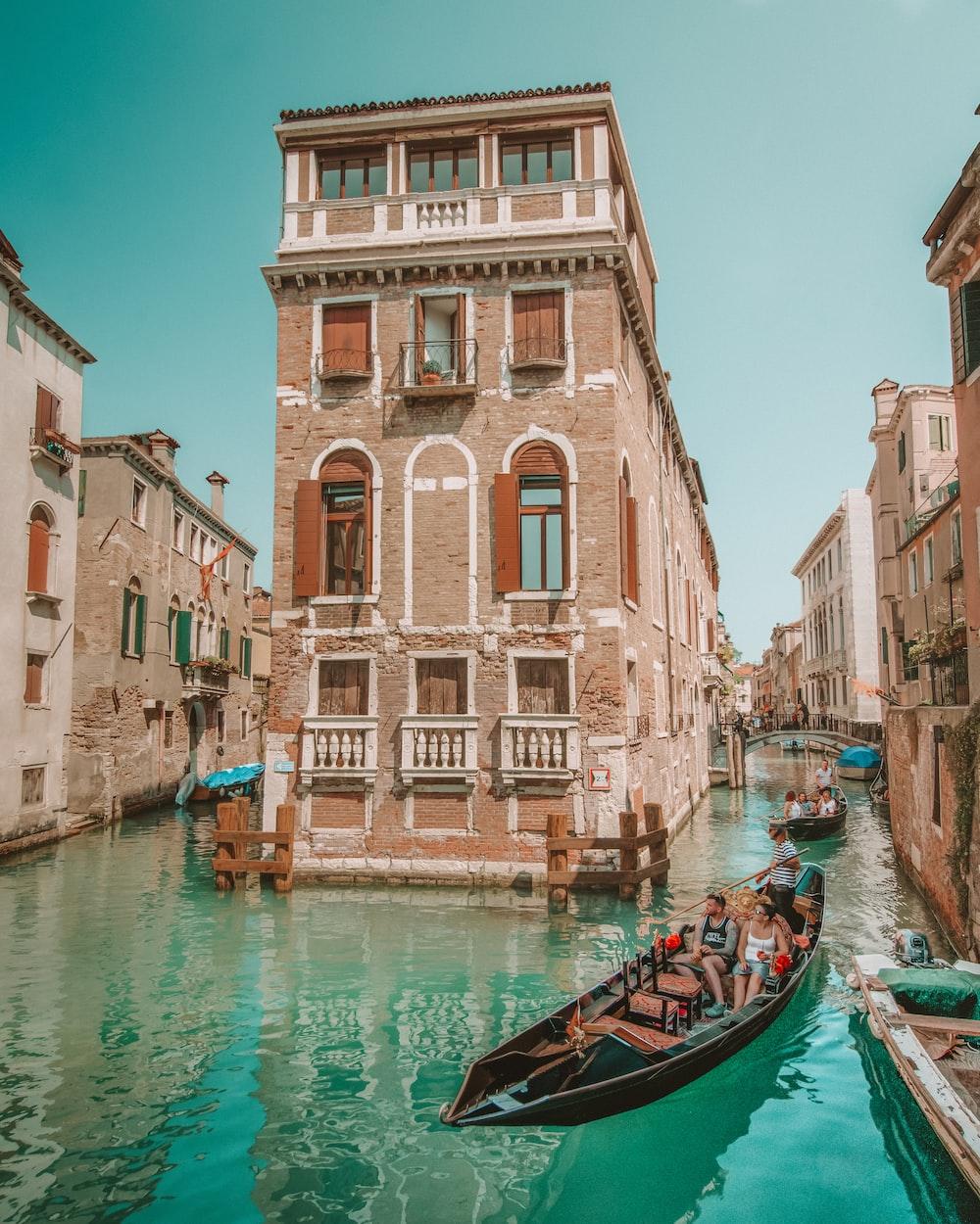 brown boat on water near buildings