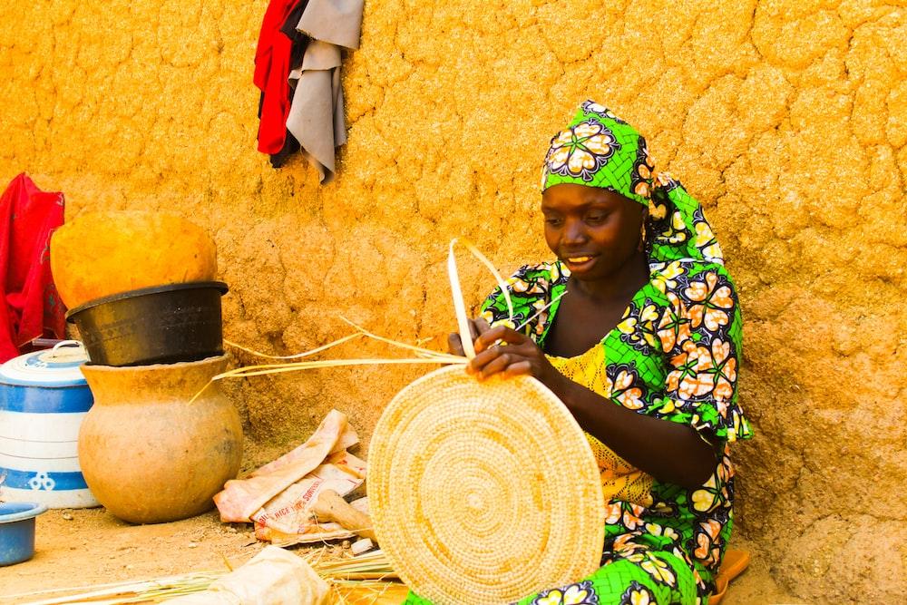 woman making basket