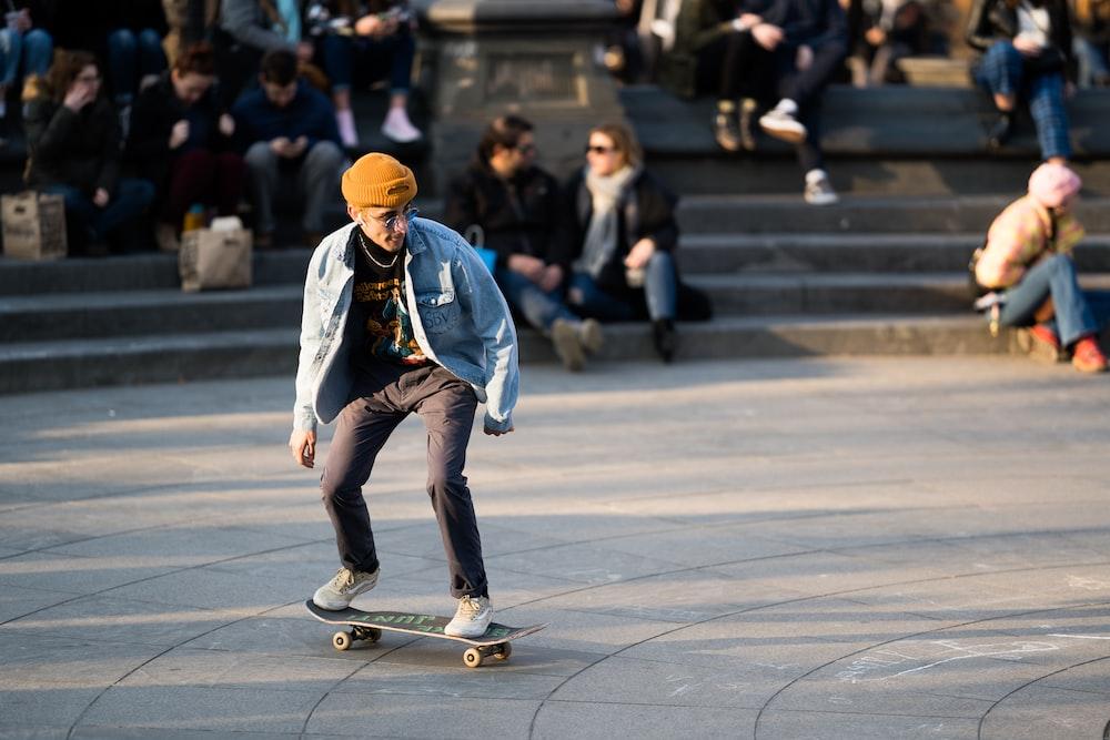 people watching man riding on skateboard